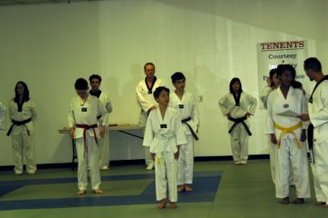 Shows kids lined up for a tae kwon do class